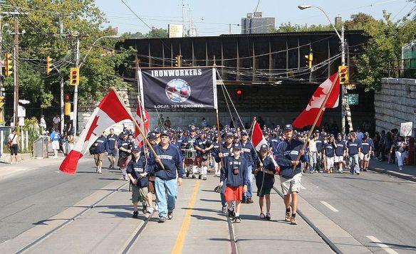 Photo credit: Lance Dutchak, Wikimedia Commons, Labour Day Parade, Ironworkers, Toronto, 2008